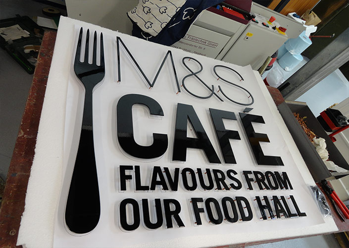 M&S Tasting Cafe Sign