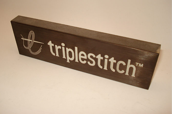 Triple Stitch bronze patina engraved and infilled