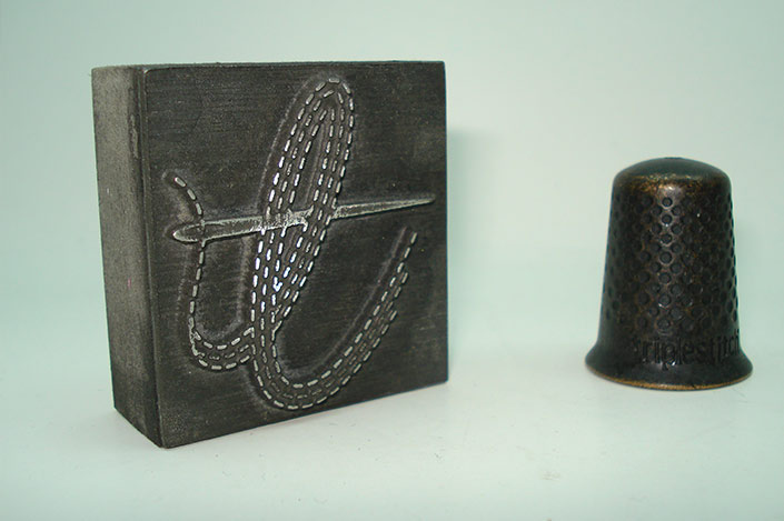 Cast metal ink block and thimble