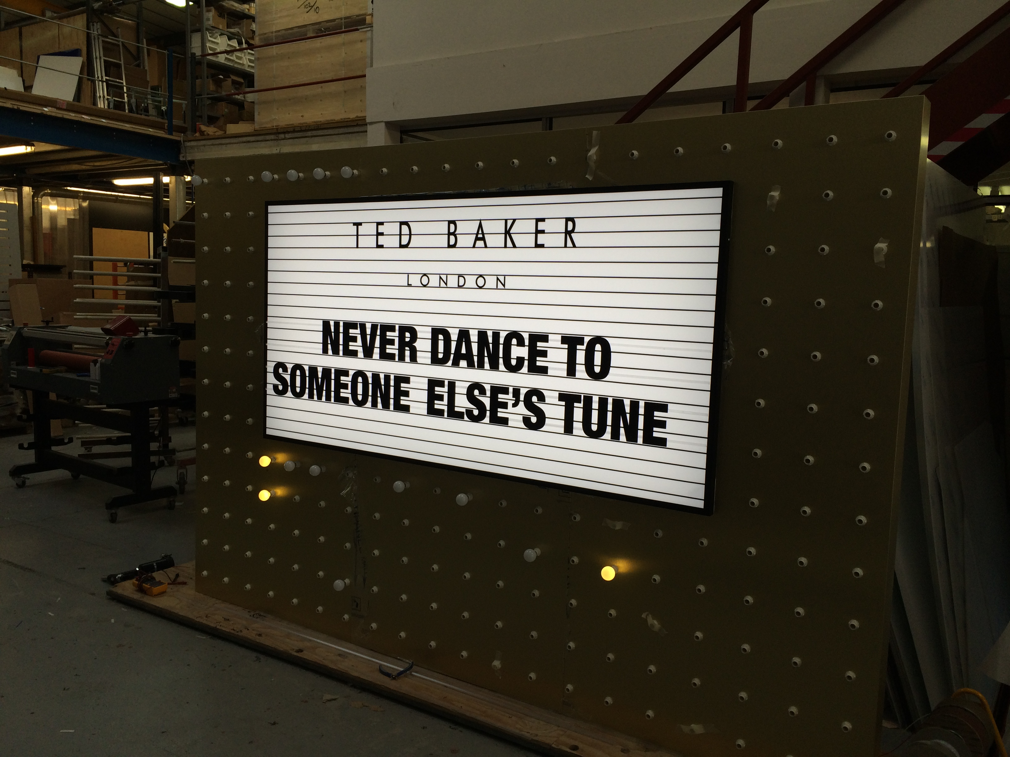 Ted Baker light box and bulb wall in workshop